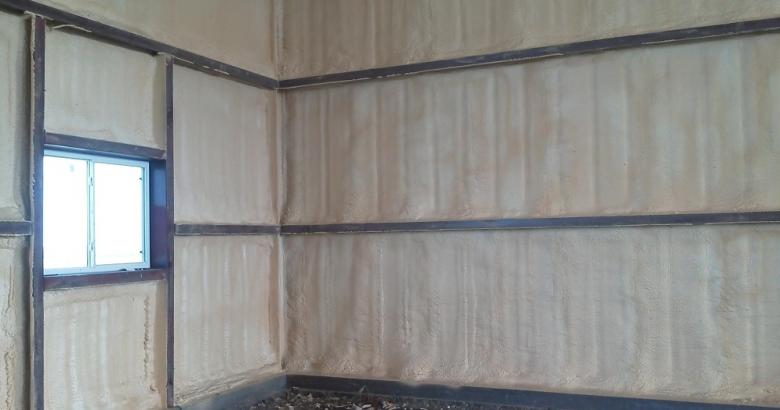 Spray foam insulation in steel building